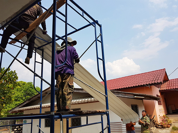 Installing metal roofing sheets