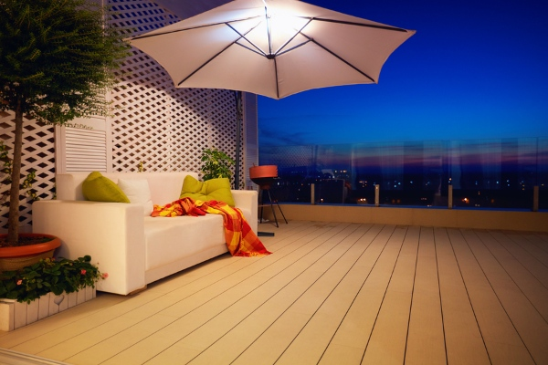 beautiful view of roof deck at night