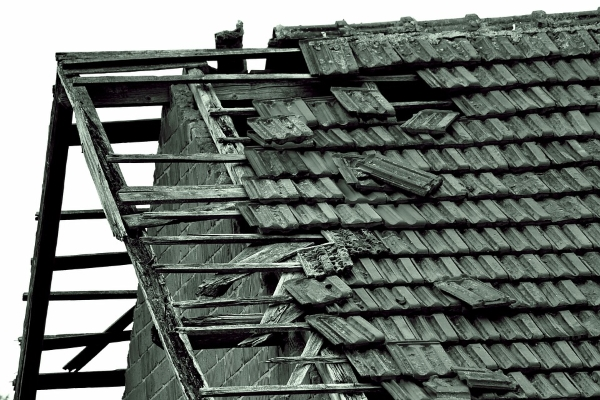 a barn's aging shingle hip roof
