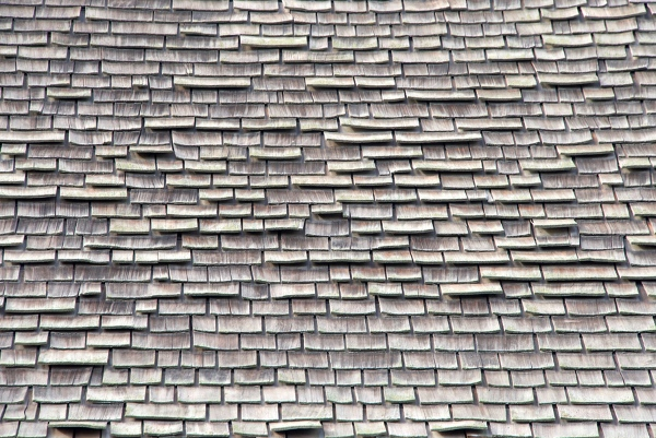 close up view of old wood roof shingles