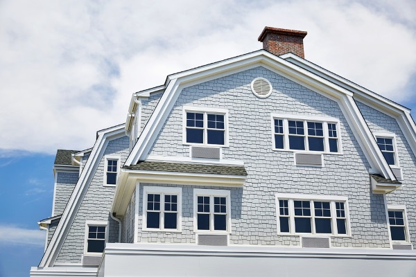 a hybrid gambrel roof residence