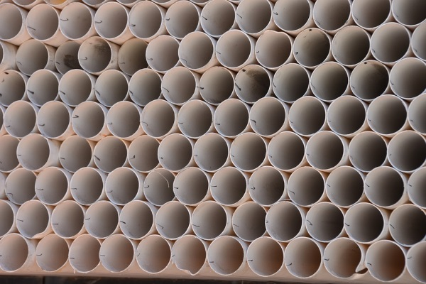 similar-sized pvc pipes stacked together