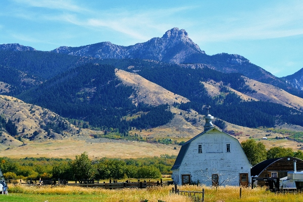 barn house with mountains in background