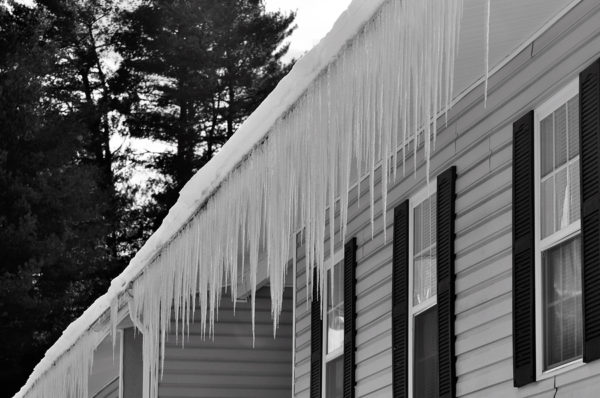Long heavy icicles posing an ice damage risk