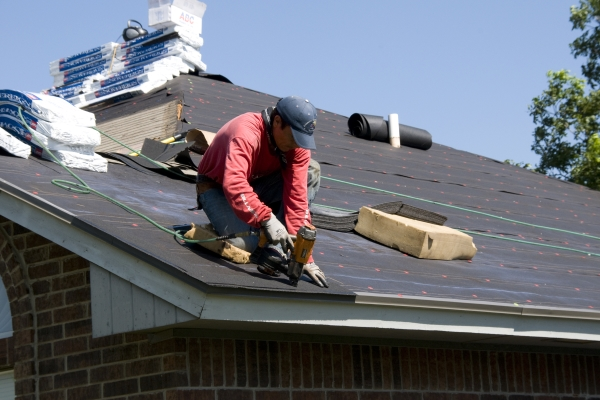 a roofing contractor addressing roofing repairs for a property