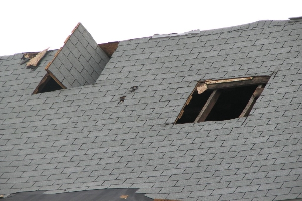 concrete tile roof with major roofing damage