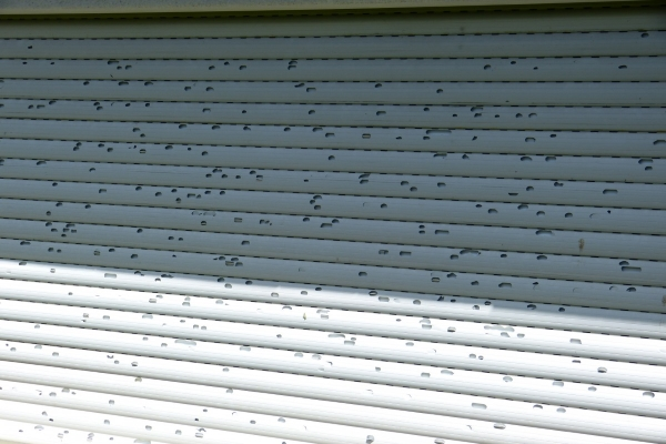 extensive siding damage due to hailstorm