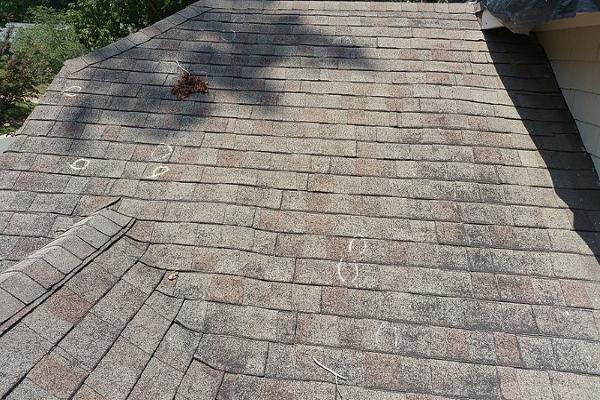 marked hailstone penetration across an asphalt shingle roof