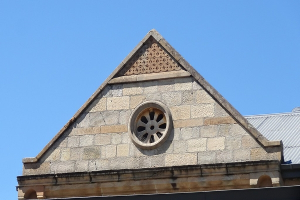 traditional gable vent on brickwalled property